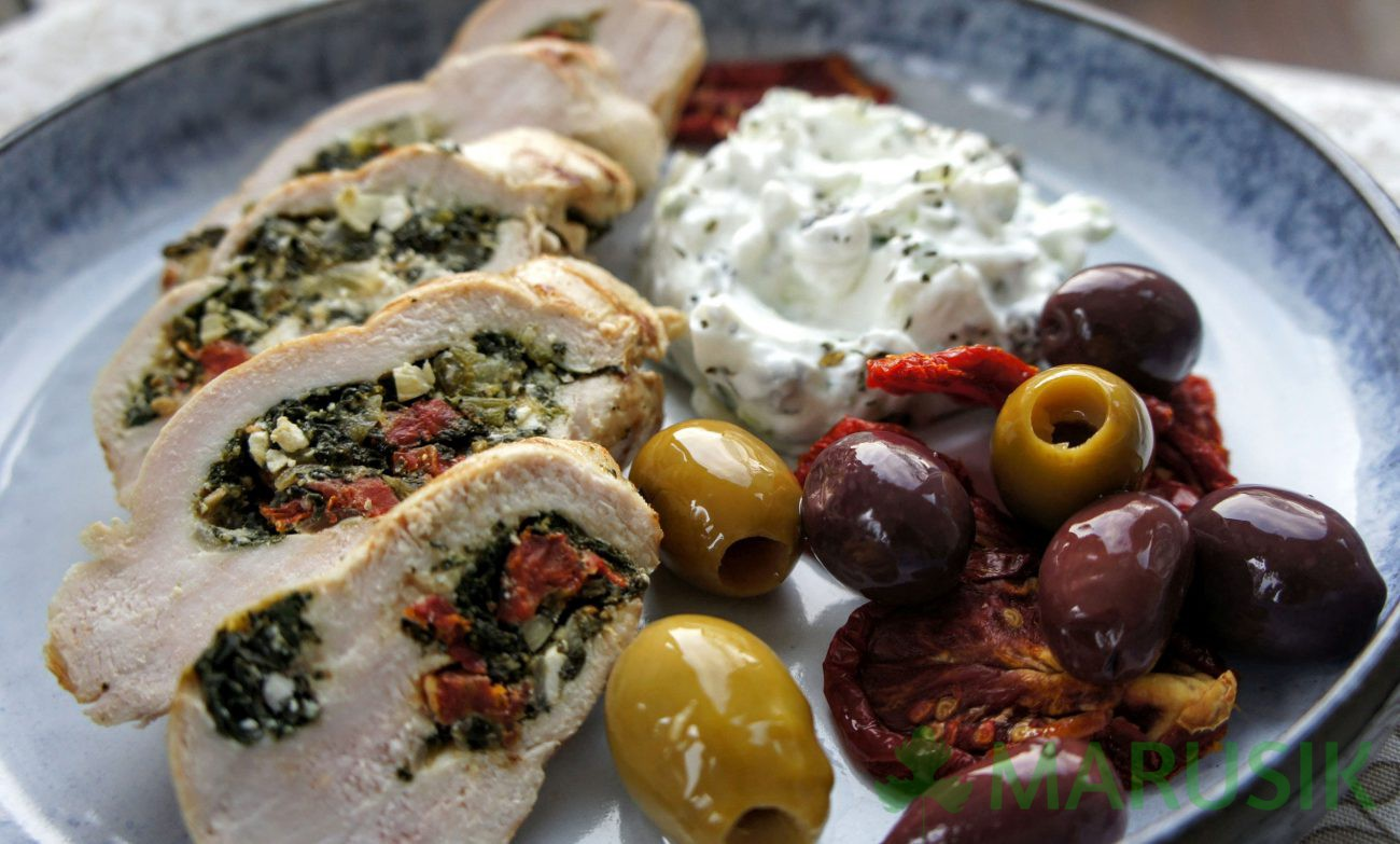 Spinach and dry tomatoes stuffed chicken breast with Greek yogurt sauce